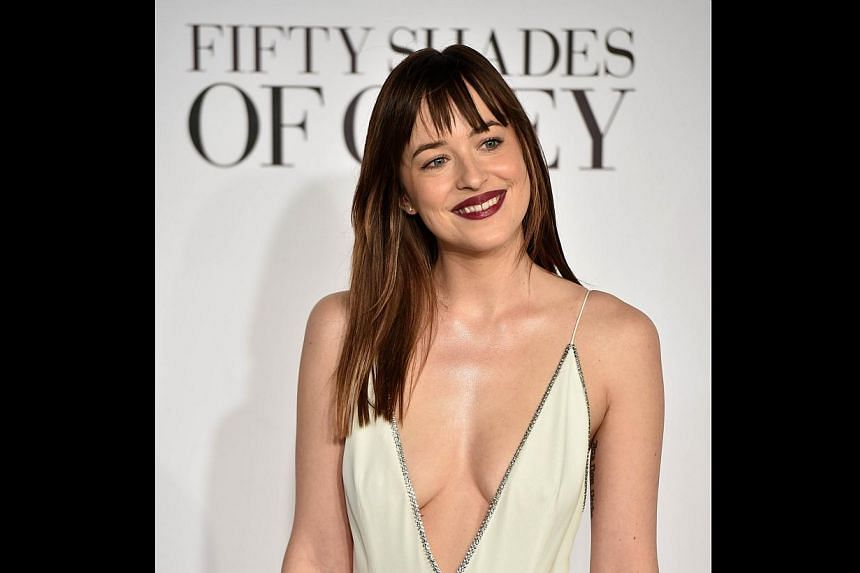 US actress Dakota Johnson poses for photographers ahead of the British Premiere of Fifty Shades of Grey in London on Feb 12. -- PHOTO: AFP