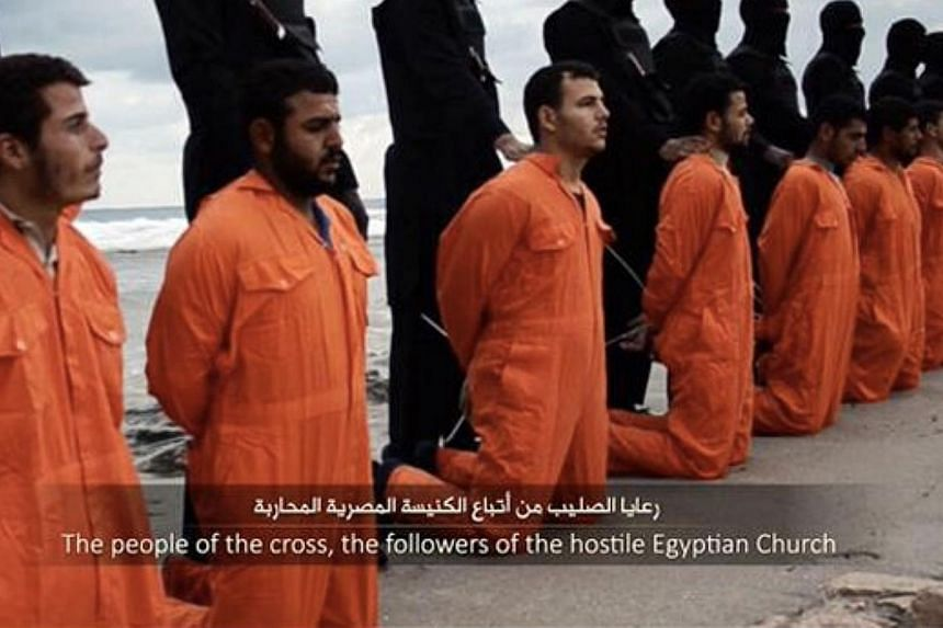 ISIS released a video on Sunday purporting to show the militant group beheading 21 Egyptian Christians kidnapped in Libya. -- PHOTO: IMAGE GRAB FROM VIDEO
