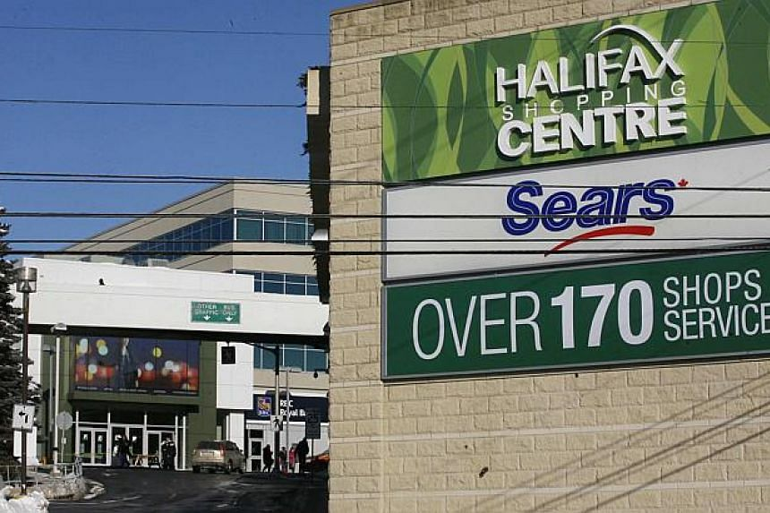Police cars are seen outside the Halifax Shopping Centre, which was named by police as the intended target of an attack which they said was thwarted in Halifax, Nova Scotia on Valentine's Day. -- PHOTO: REUTERS