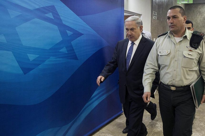 Israel's Prime Minister Benjamin Netanyahu arrives to the weekly cabinet meeting at his office in Jerusalem on Sunday. --PHOTO: REUTERS