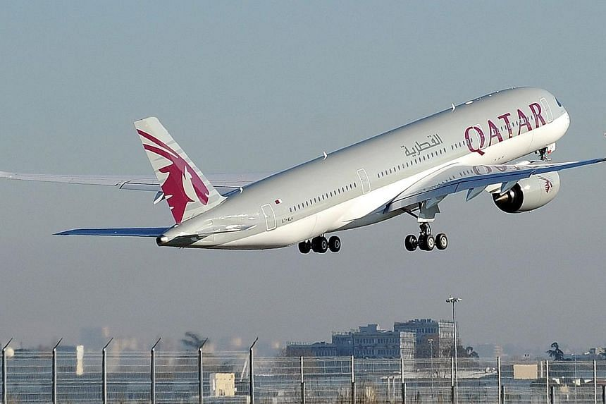 In June, Doha-based Qatar Airways will add a third daily flight to Changi Airport, and by August all three flights will be operated with the Airbus 350 - the newest wide-body aircraft in the market. -- PHOTO: AFP