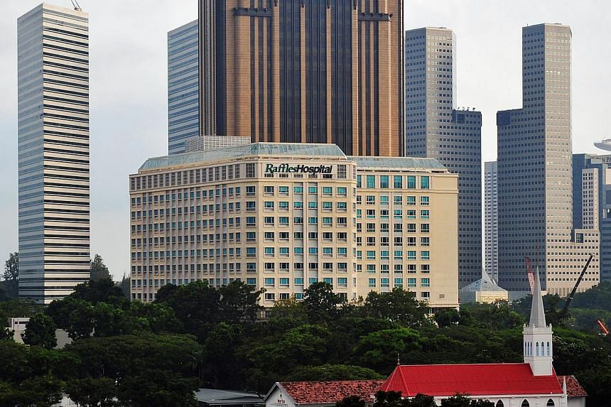 Raffles said all divisions of the group contributed to the increase, with revenue from health care and hospital services increasing by 12.5 and 8.4 per cent, respectively. -- PHOTO: ST FILE
