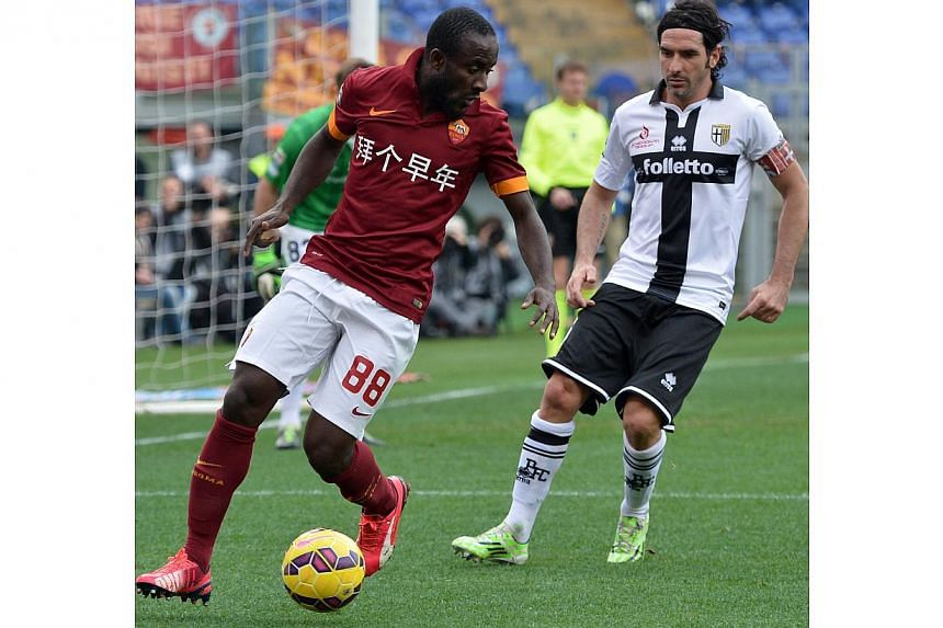 AS Roma's Seydou Doumbia (left) fighting for the ball with Parma's Alessandro Lucarelli on Feb 15, 2015. -- PHOTO: AFP
