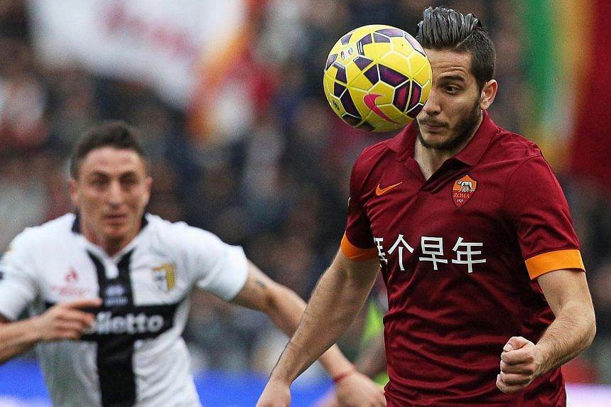 Roma's Kostas Manolas (right) in action against Parma FC on Feb 15, 2015. -- PHOTO: EPA