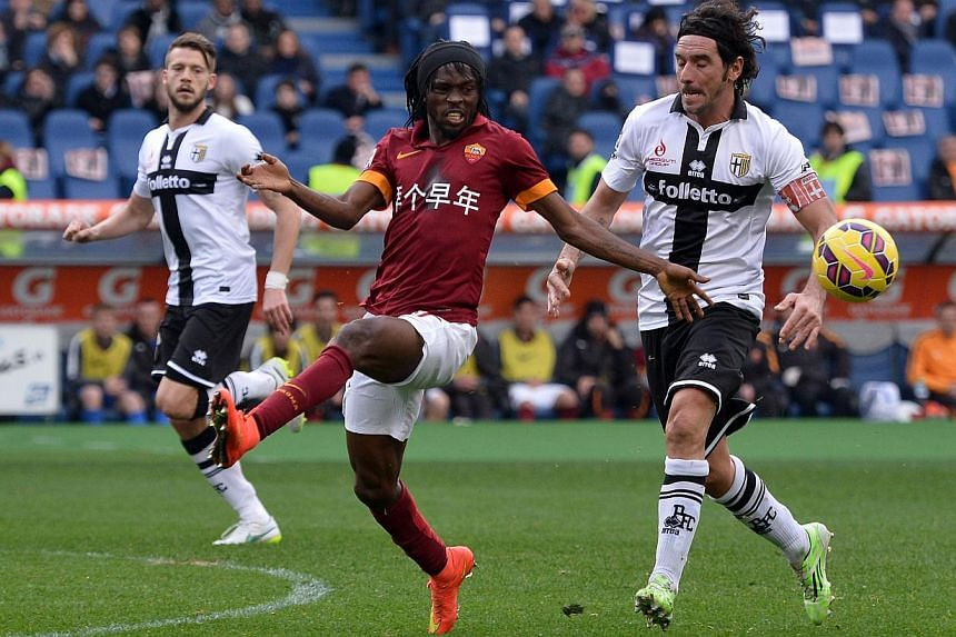 AS Roma's Gervinho (left) fighting for the ball with Fiorentina's Alessandro Lucarelli on Feb 15, 2015. -- PHOTO: AFP
