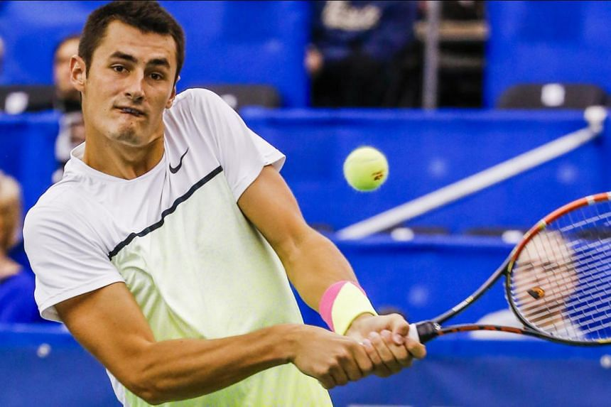 Bernard Tomic of Australia hits a return shot to Alexandr Dolgopolov (above) of Ukraine in their quarter-round Memphis Open tennis match at the Racquet Club of Memphis in Memphis, Tennessee, US, on Feb 12, 2015. -- PHOTO: EPA