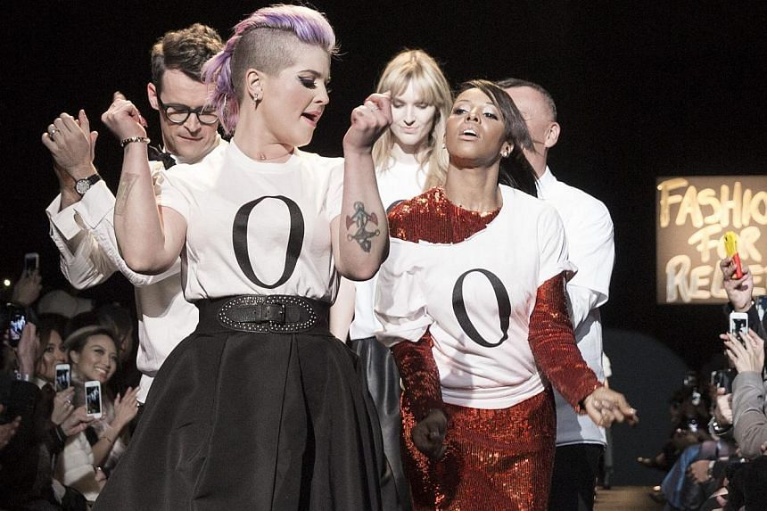 """Kelly Osbourne leads participants down the runway during """"Naomi Campbell's Fashion For Relief"""" at New York Fashion Week on Feb 14, 2015. -- PHOTO: REUTERS"""
