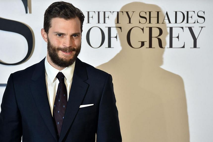 British actor Jamie Dornan poses for photographers ahead of the UK Premiere of Fifty Shades of Grey in central London on Feb 12, 2015. Netflix next year will release Jadotville, a war film starring the 50 Shades Of Gray star. -- PHOTO: AFP