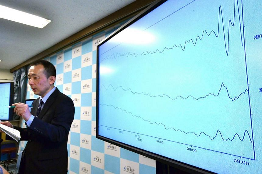 An earthquake expert from Japan's Meteorological Agency at a press conference at its headquarters in Tokyo on Feb 17, 2015. -- PHOTO: AFP
