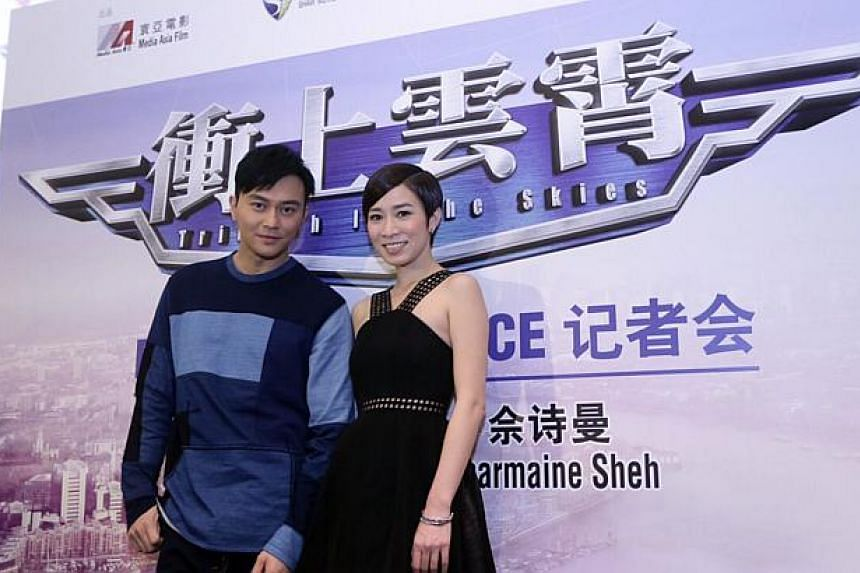 Hong Kong actors Julian Cheung and Charmaine Sheh at a press conference for the movie Triumph In The Skies today on Feb 16, 2015. -- PHOTO: GOLDEN VILLAGE PICTURES
