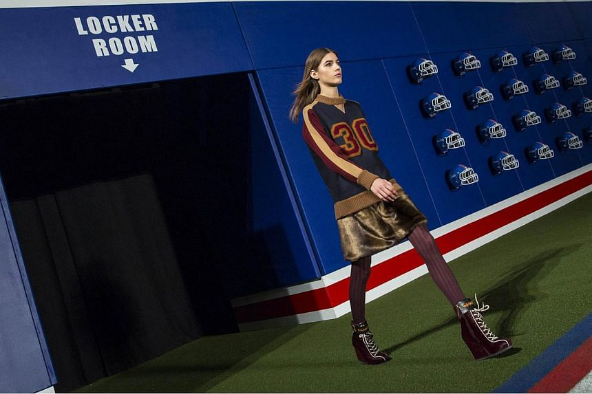 A model enters the arena during rehearsals for the Tommy Hilfiger Fall/Winter 2015 collection at the New York Fashion Week on Feb 16, 2015. -- PHOTO: REUTERS