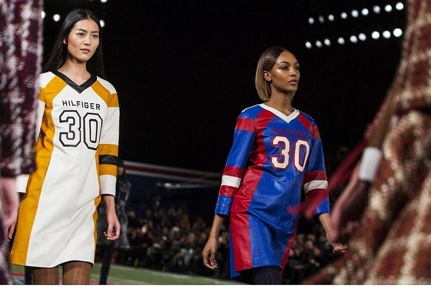 Models, including Jourdan Dunn (right), present creations from the Tommy Hilfiger Fall/Winter 2015 Collection at the New York Fashion Week on Feb 16, 2015. -- PHOTO: REUTERS