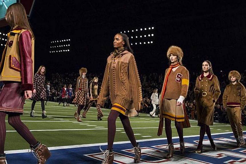 Models present creations from the Tommy Hilfiger Fall/Winter 2015 Collection at the New York Fashion Week on Feb 16, 2015. -- PHOTO: REUTERS