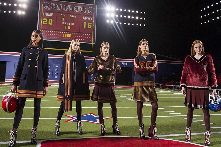 Models pose before presenting the Tommy Hilfiger Fall/Winter 2015 collection at the New York Fashion Week on Feb 16, 2015. -- PHOTO: REUTERS