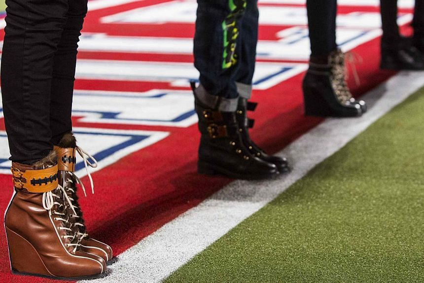 Models line the end zone line during rehearsals for the Tommy Hilfiger Fall/Winter 2015 collection presentation at New York Fashion Week on Feb 16, 2015. -- PHOTO: REUTERS