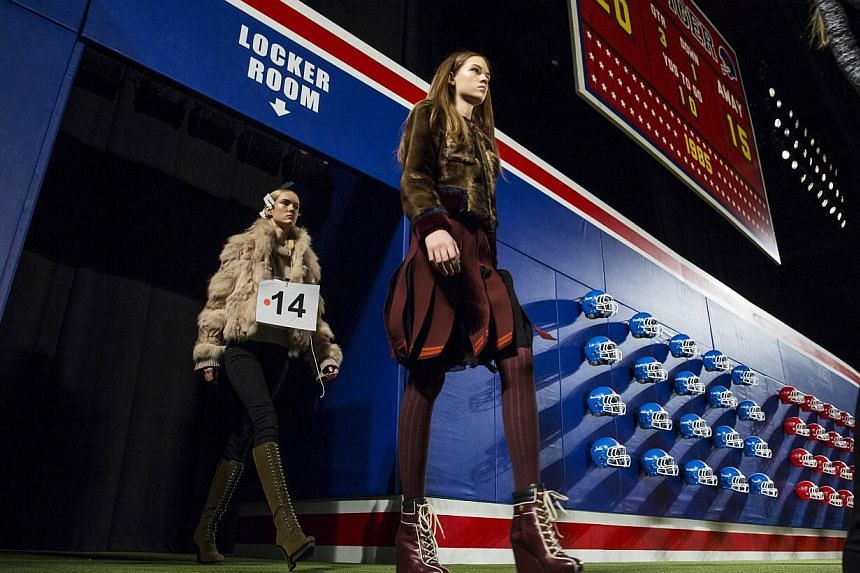 Models enter the arena during rehearsals for the Tommy Hilfiger Fall/Winter 2015 collection presentation at the New York Fashion Week on Feb 16, 2015. -- PHOTO: REUTERS