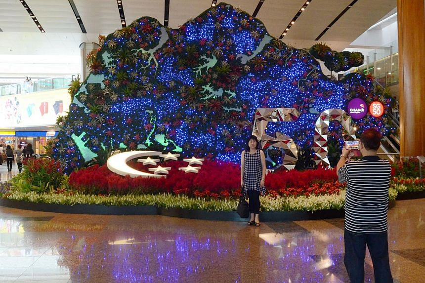 """The display at Terminal 2 is the main highlight in a line up of activities and events, centred on the theme """"Changi, I'm Home"""", planned for Singapore's 50th birthday this year, Changi Airport Group (CAG) said.-- PHOTO: CHANGI AIRPORT"""