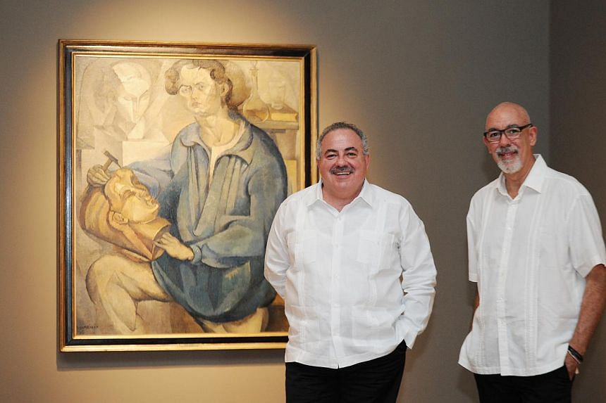 Three highlights at the exhibition are Paisaje De Toledo (above), Nude With Sunflowers (above right) and Pico De Orizaba (below). Mr Rogelio Granguillhome, ambassador of Mexico to Singapore (left), and writer Santiago Espinosa de los Monteros at the
