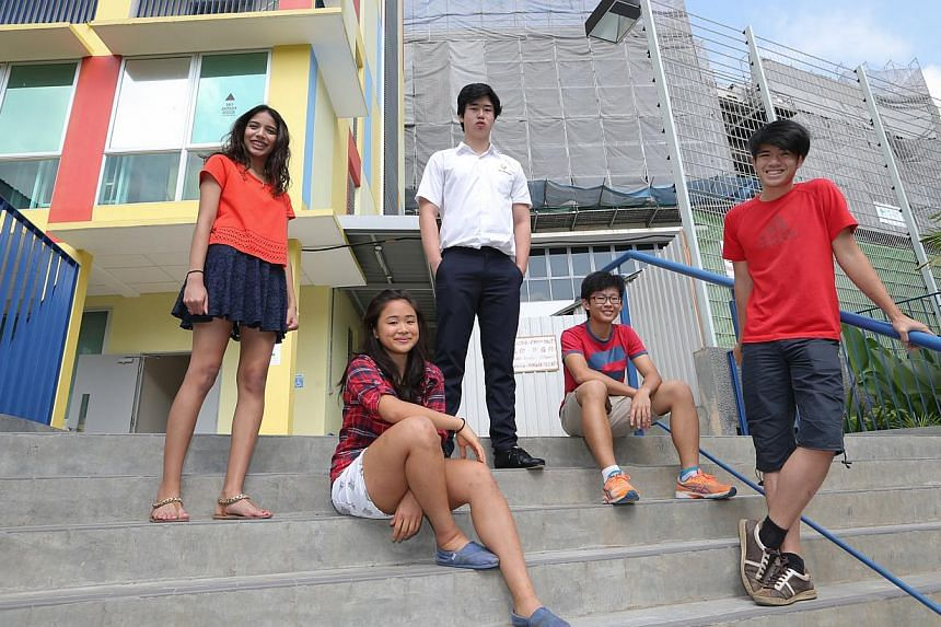 Singaporean ACS (International) students (from left) Salima Sheryl, Emily Ong, Joshua Tan Wee Kiat, Ammon Ng Tzu-Herng and Samuel Lee Zheng Yu. The school expanded its facilities at its Holland Village campus last year and has already seen its enrolm