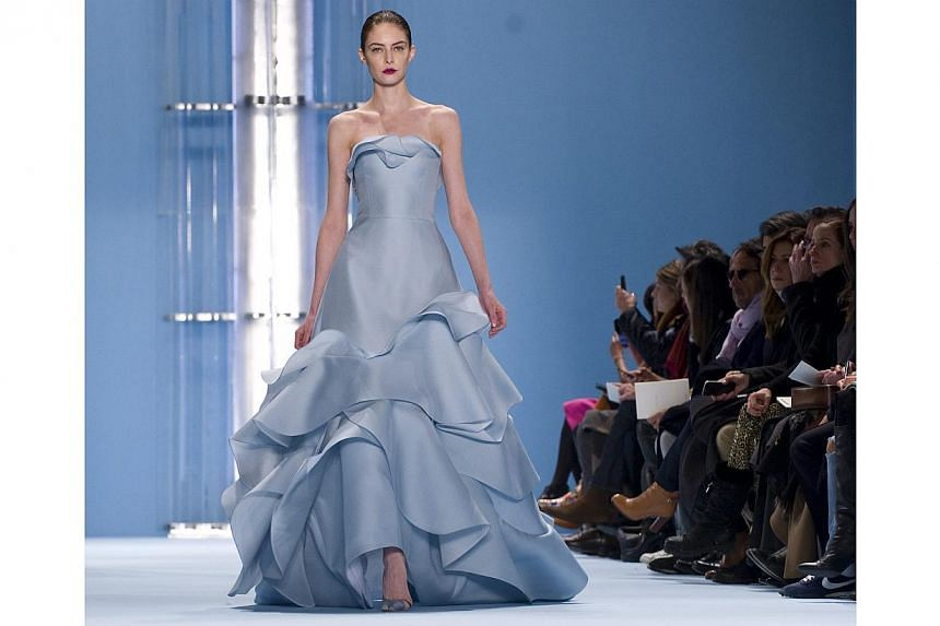 A model presents a creation from the Fall 2015 collection by Venezuelan-US designer Carolina Herrera, during the Mercedes Benz Fashion Week in New York on Feb 16, 2015. Designer Carolina Herrera took her love for water and turned it into a colle