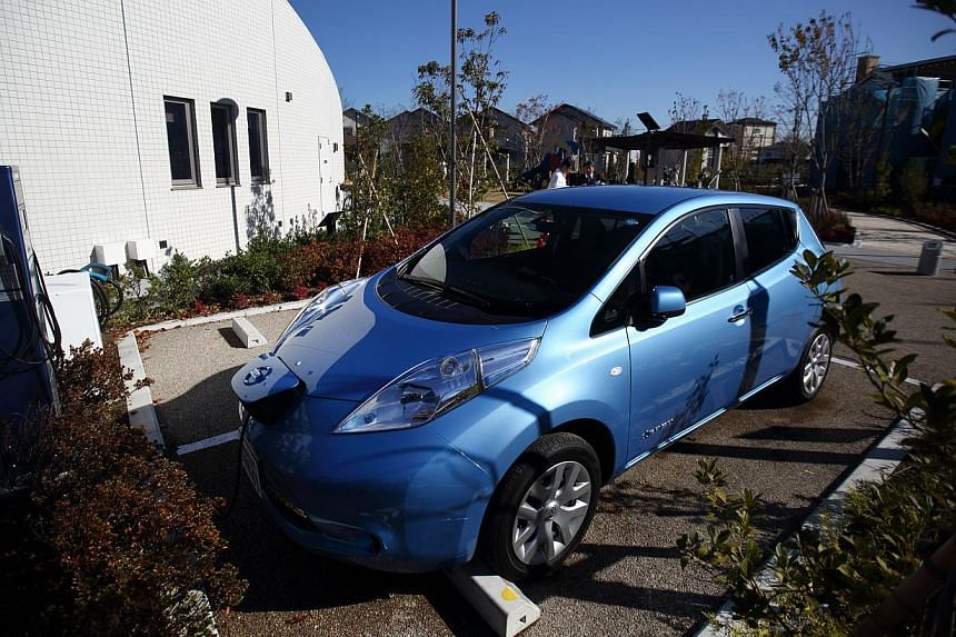 Japan now has more electric vehicle charging spots than gas stations. The country's number-two automaker Nissan says there are now 40,000 charging units, compared with 34,000 petrol stations. -- PHOTO: BLOOMBERG