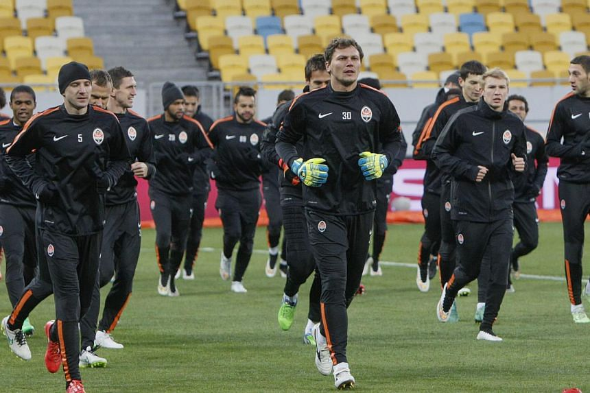 Shakhtar Donetsk's players take part in a training session at the Lviv Arena stadium in Lviv on Feb 16, 2015.The team is hoping a surprise Champions League victory over 2013 winners Bayern Munich on Tuesday can bring some brief cheer to their t