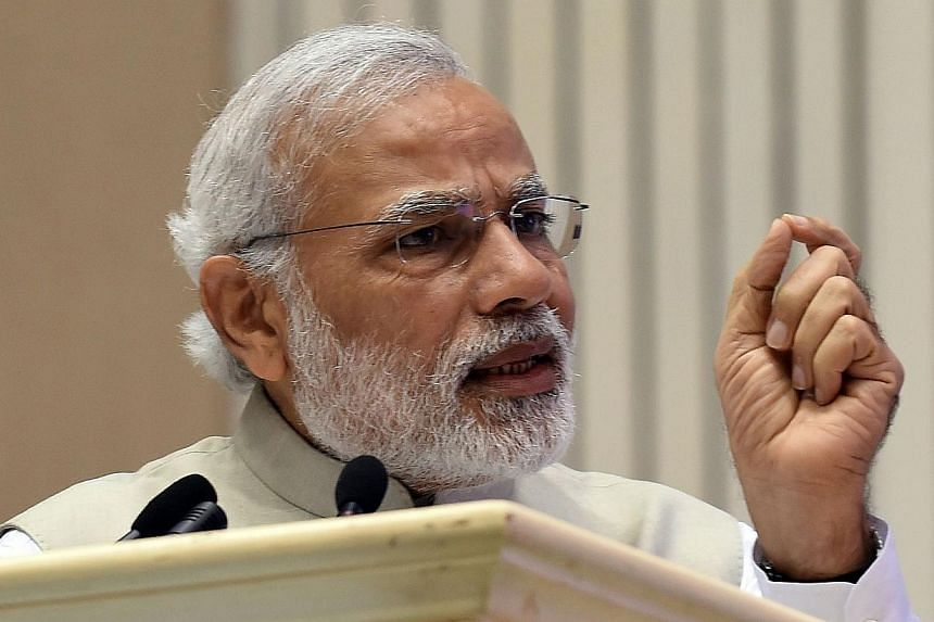 Indian Prime Minister Narendra Modi gestures as he speaks during the opening of the first Renewable Energy Global Investors conference in New Delhi on Feb 15, 2015.Indian Prime Minister Narendra Modi vowed on Tuesday to protect all religious gr