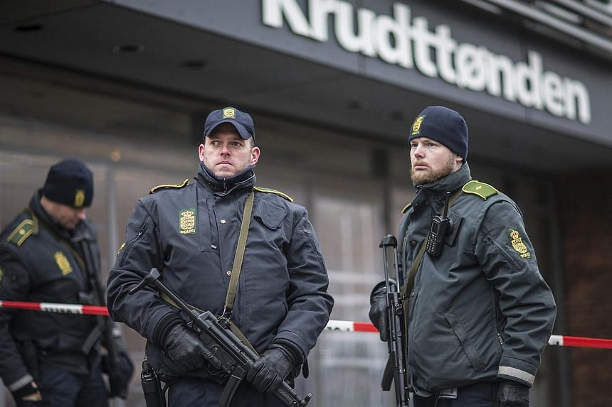 Police guard the scene of a shooting at cafe 'Krudttonden,' which was hosting a free speech event, in Oesterbro, Copenhagen, on Feb 16, 2015.A suspect package was found outside the cafe and the area has been evacuated, police there told a Reute