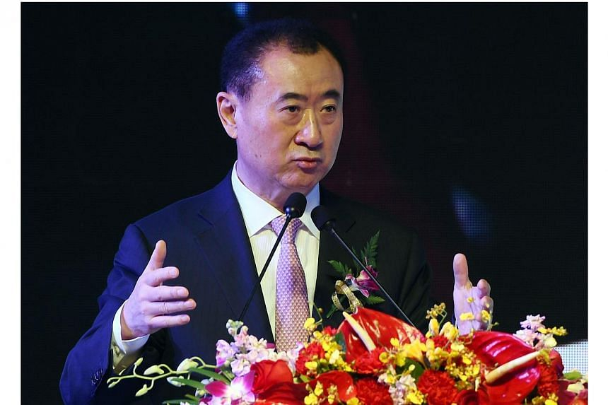 "The son of China's second-richest man Wang Jianlin (above), Wang Sicong, is at the centre of a media storm after telling reporters that his top criterion for choosing a girlfriend was that she had to be ""buxom"".  -- PHOTO: AFP"
