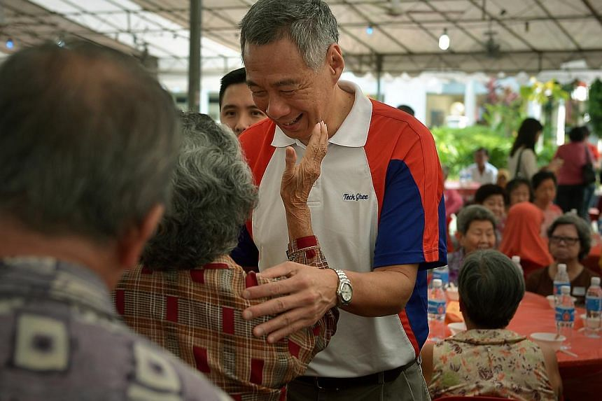 PM Lee Hsien Loong meeting elderly residents at the Teck Ghee Division Hongbao Presentation Ceremony 2015. As generations of family members gather for their Chinese New Year reunion feast on Wednesday, Mr Lee urged Singaporeans not to overlook the im