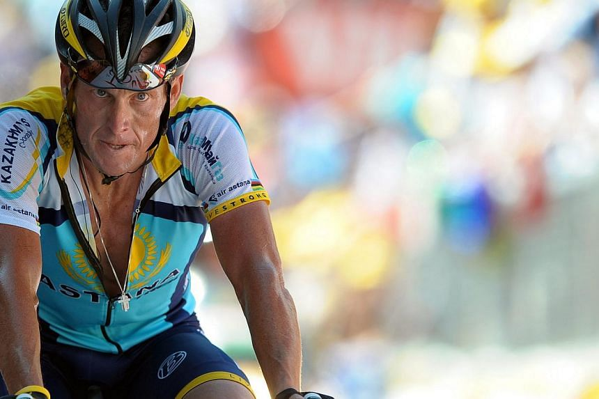US rider Lance Armstrong of the Astana team crossing the finish line of the 15th stage of the Tour de France cycling race between Pontarlier and Verbier, Switzerland on July 19, 2009. -- PHOTO: EPA