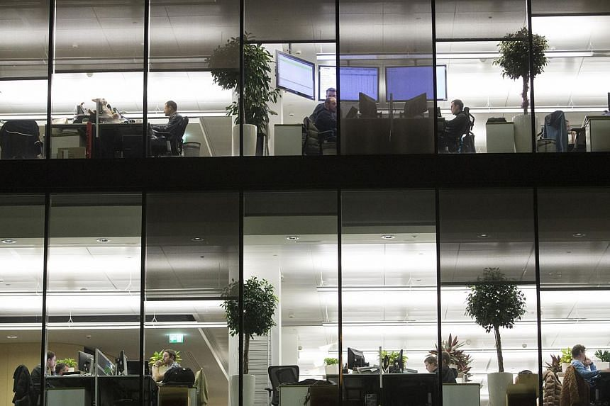 "Employees work at their desks in offices inside the headquarters of Kaspersky Lab, a cyber-security firm, in Moscow, Russia, on Dec. 9, 2014. ""Hackers have become capable of carrying out very advanced attacks,"" Kaspersky said. -- PHOTO: BLOOMBERG"