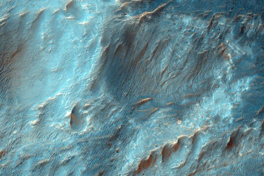 This NASA image obtained Feb 12 shows Bigbee, a 21 kilometre-diameter impact crater located on the northern rim of Holden crater in southern Margaritifer Terra, a region on Mars that is well known for its long record of water-rich activity. --PHOTO: