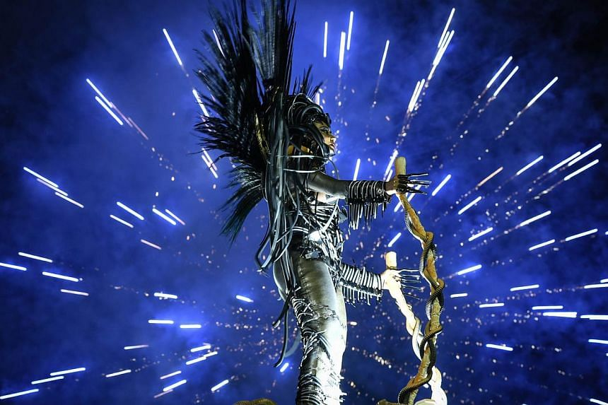 Revelers of the Unidos da Tijuca samba school perform during the second day of carnival parade in the Sambodrome in Rio de Janeiro, Brazil on Tuesday. -- PHOTO: AFP