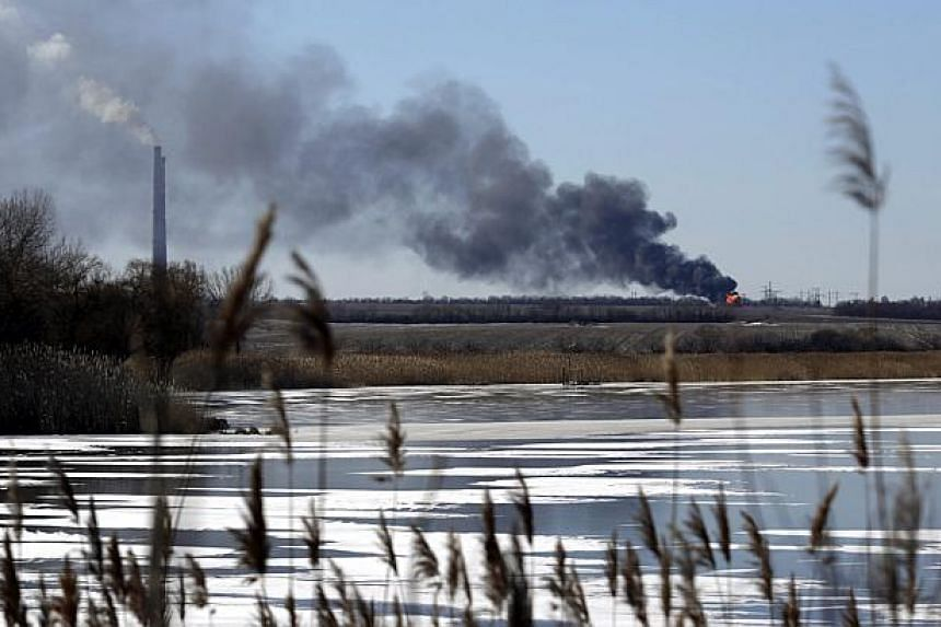A view of an explosion is seen from the shelled gas pipe near the power station, not far from Debaltseve of Donetsk area, Ukraine on Monday. Separatist rebels in eastern Ukraine say that they have taken large parts of Debaltseve, the strategic rail h