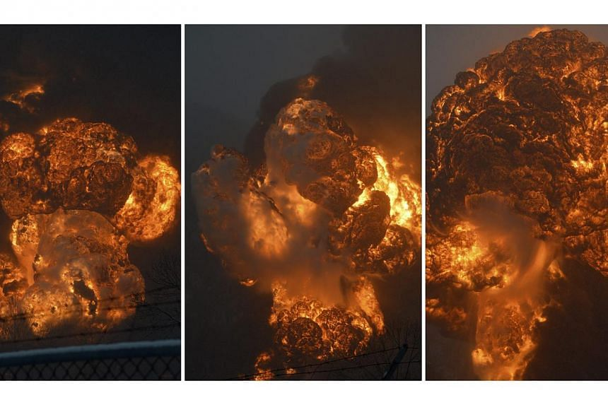 A combination photo shows a sequence of an explosion erupting from the CSX Corp train derailment in Mount Carbon, West Virginia, as seen from across the Kanawha River, on Feb 16, 2015. -- PHOTO: REUTERS