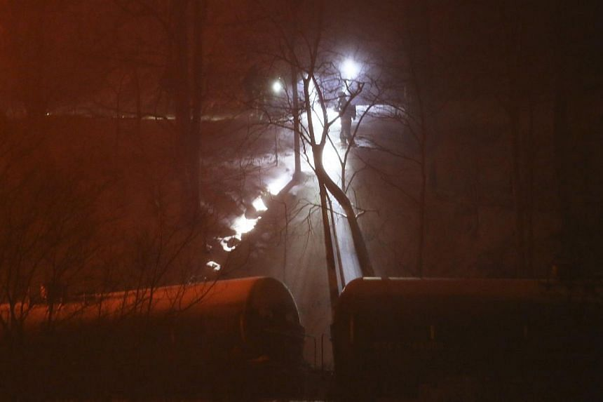 Firefighters inspect derailed train cars after the CSX Corp train derailed in Mount Carbon, West Virginia, on Feb 16, 2015. -- PHOTO: REUTERS