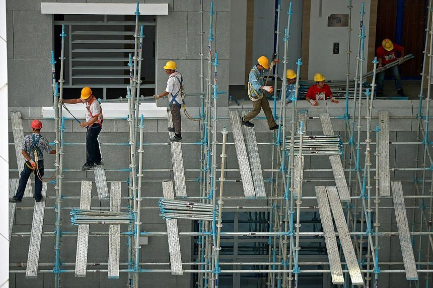 Singapore's labour productivity declined 0.8 per cent in 2014, after falling in both 2012 and 2013. The latest data comes amid ongoing efforts to restructure the economy and raise productivity. -- ST PHOTO: KUA CHEE SIONG