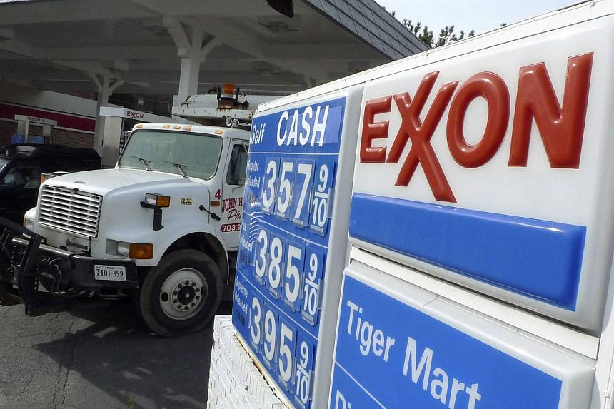 An Exxon gas station is pictured in Arlington, Virginia in a Jan 31, 2012 file photo. Warren Buffett's Berkshire Hathaway exited a US$3.7 billion investment in Exxon Mobil Corp. amid a slump in oil prices. -- PHOTO: REUTERS