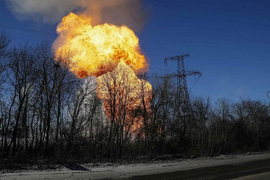 An explosion is seen near the town of Debaltseve after shelling in the area on Feb 17, 2015, despite a ceasefire between Ukrainian government forces and pro-Russian separatists being in effect. -- PHOTO: REUTERS