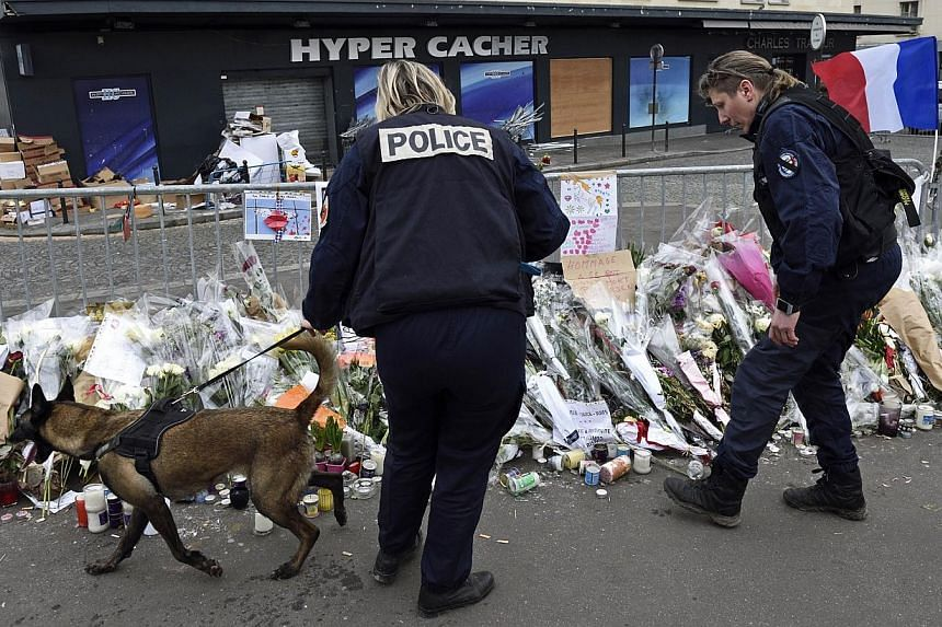 Policemen patrolling on Jan 21, 2015, in front of the Hyper Cacher kosher supermarket where gunman Amedy Coulibaly killed four people on Jan 9, 2015, in Paris. -- PHOTO: AFP