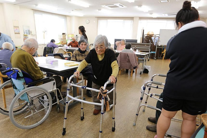 Elderly people at a day care facility on Gogo Island in Matsuyama, Japan, on March 22, 2013. Scores of elderly people living in sheltered accommodation in Tokyo have been routinely tied to their beds or locked in their rooms, officials say, highlight