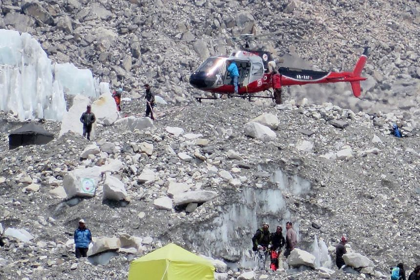 In this photograph taken on April 18, 2014, a Nepalese rescue helicopeter lands at Everest Base Camp during rescue efforts following an avalanche that killed sixteen Nepalese sherpas in the Khumbu icefall at the base of Mount Everest.-- PHOTO: