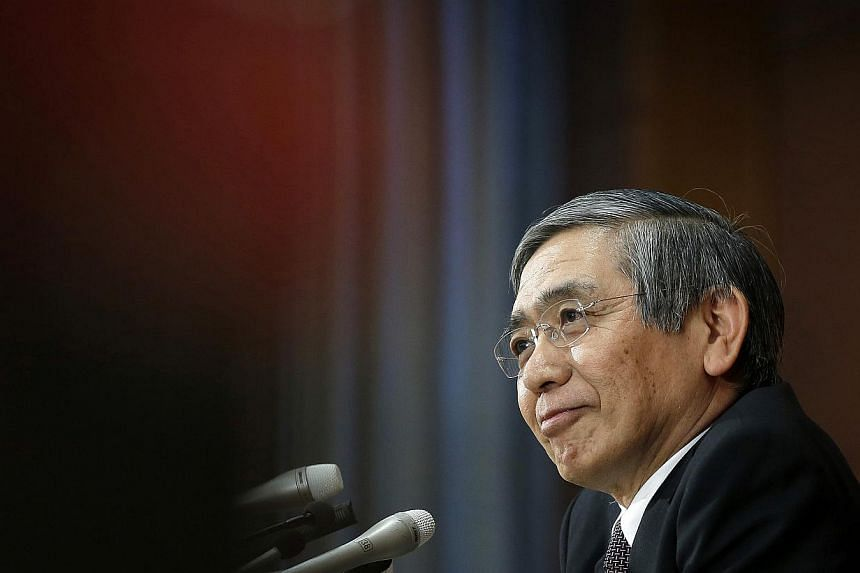Bank of Japan governor Haruhiko Kuroda during a news conference at the central bank's headquarters in Tokyo, Japan, on Jan 21, 2015. -- PHOTO: BLOOMBERG