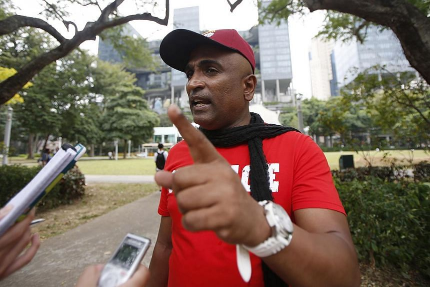 M. Ravi speaks to reporters at the Speakers' Corner in Singapore on Feb 14, 2015. -- PHOTO: REUTERS