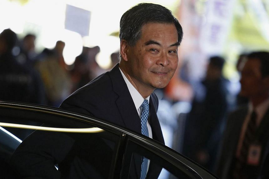 """Hong Kong Chief Executive Leung Chun-ying arriving at the Legislative Council where protesters demonstrate, to give his annual policy address in Hong Kong Jan 14, 2015. He has has told residents in his Lunar New Year address to be """"inspired"""" by this"""