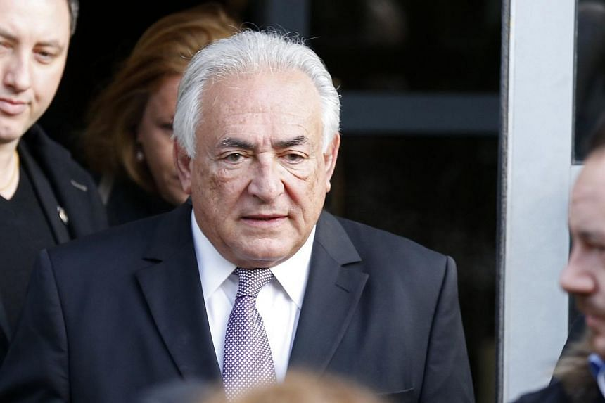 Former IMF head Dominique Strauss-Kahn leaves his hotel to attend the trial in the so-called Carlton Affair, in Lille, on Feb 18, 2015, where 14 people including Strauss-Kahn stand accused of sex offences including the alleged procuring of prostitute