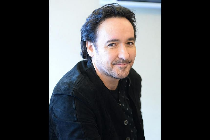 Kickboxing practitioner John Cusack (above) enjoyed his experience filming in the Silk Road region for Dragon Blade.