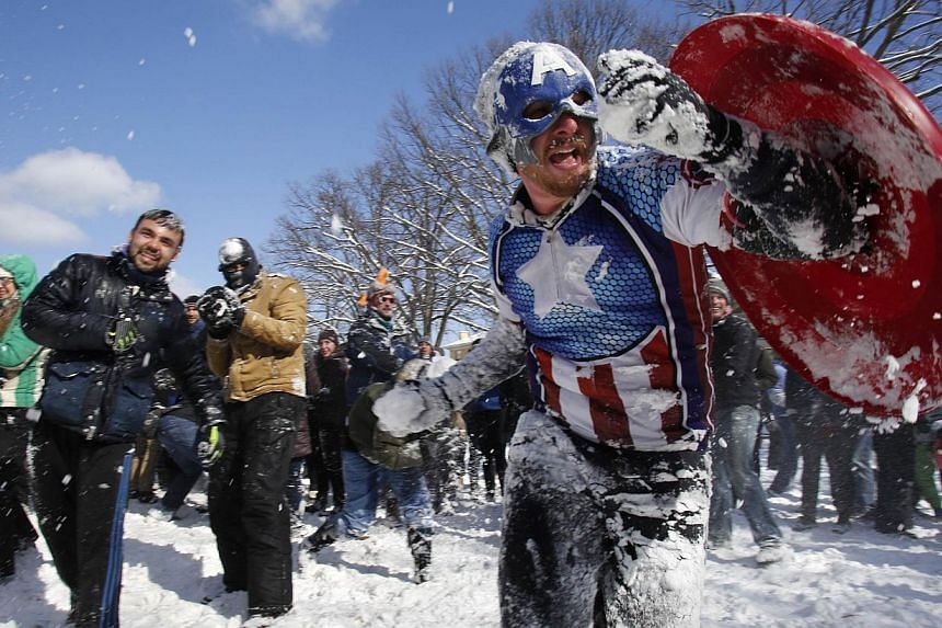 Mr Collin Lawrence, dressed up as comic superhero Captain America, joins other Washington DC residents in a massive snowball fight. -- PHOTO: REUTERS