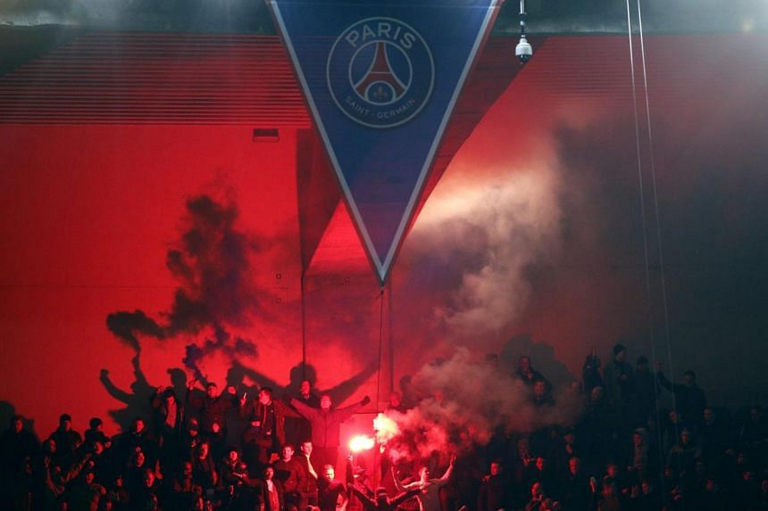 Chelsea fans lighting flares during the UEFA Champions League round of 16 first leg against Paris Saint-Germain at the Parc des Princes Stadium, in Paris, France on Feb 17, 2015. -- PHOTO: EPA